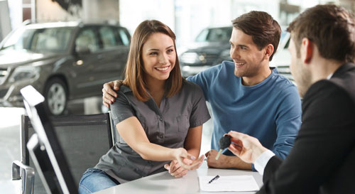 Couple receiving car keys